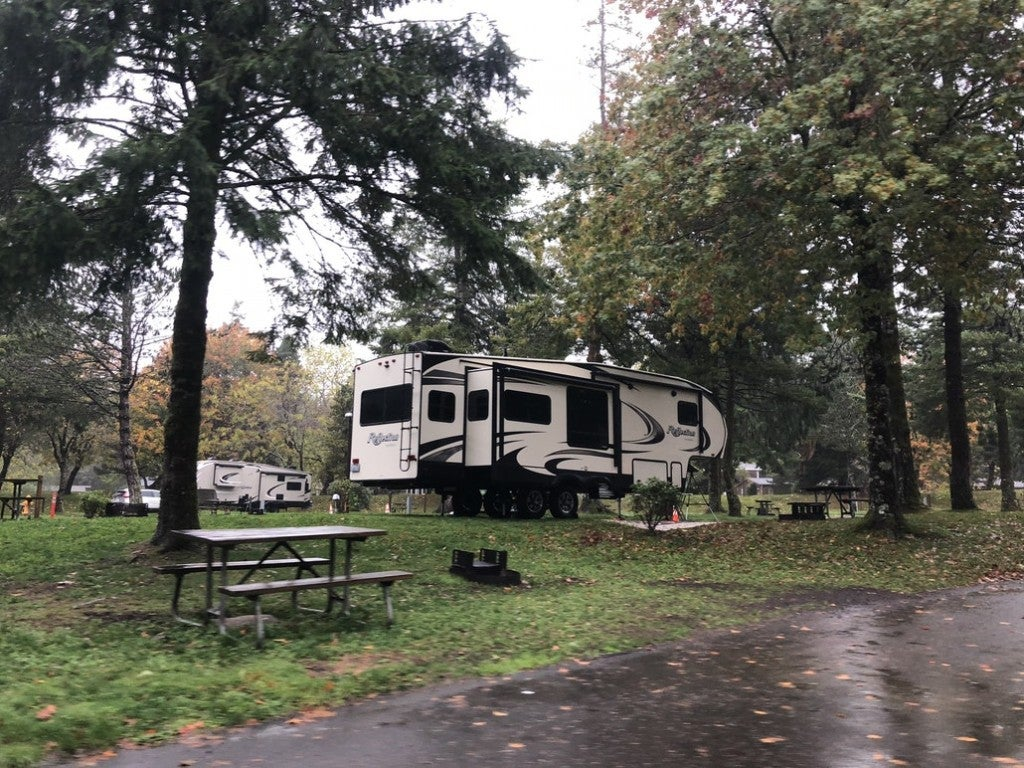 an RV parked in a campsite in the woods