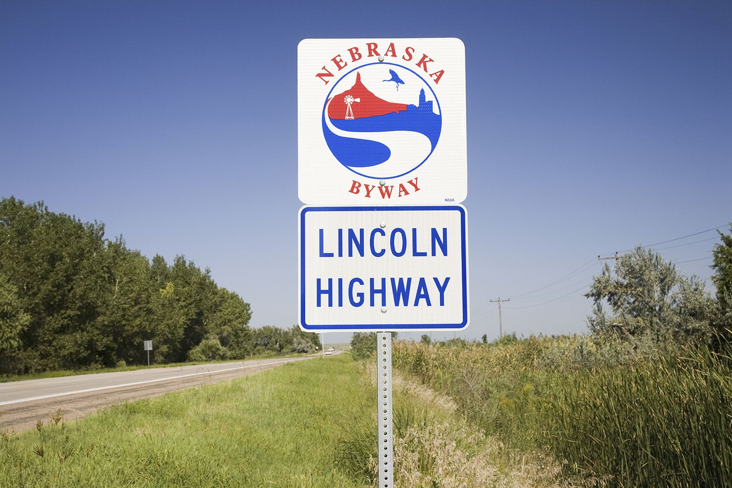 A white sign for the Old Lincoln Highway in Nebraska