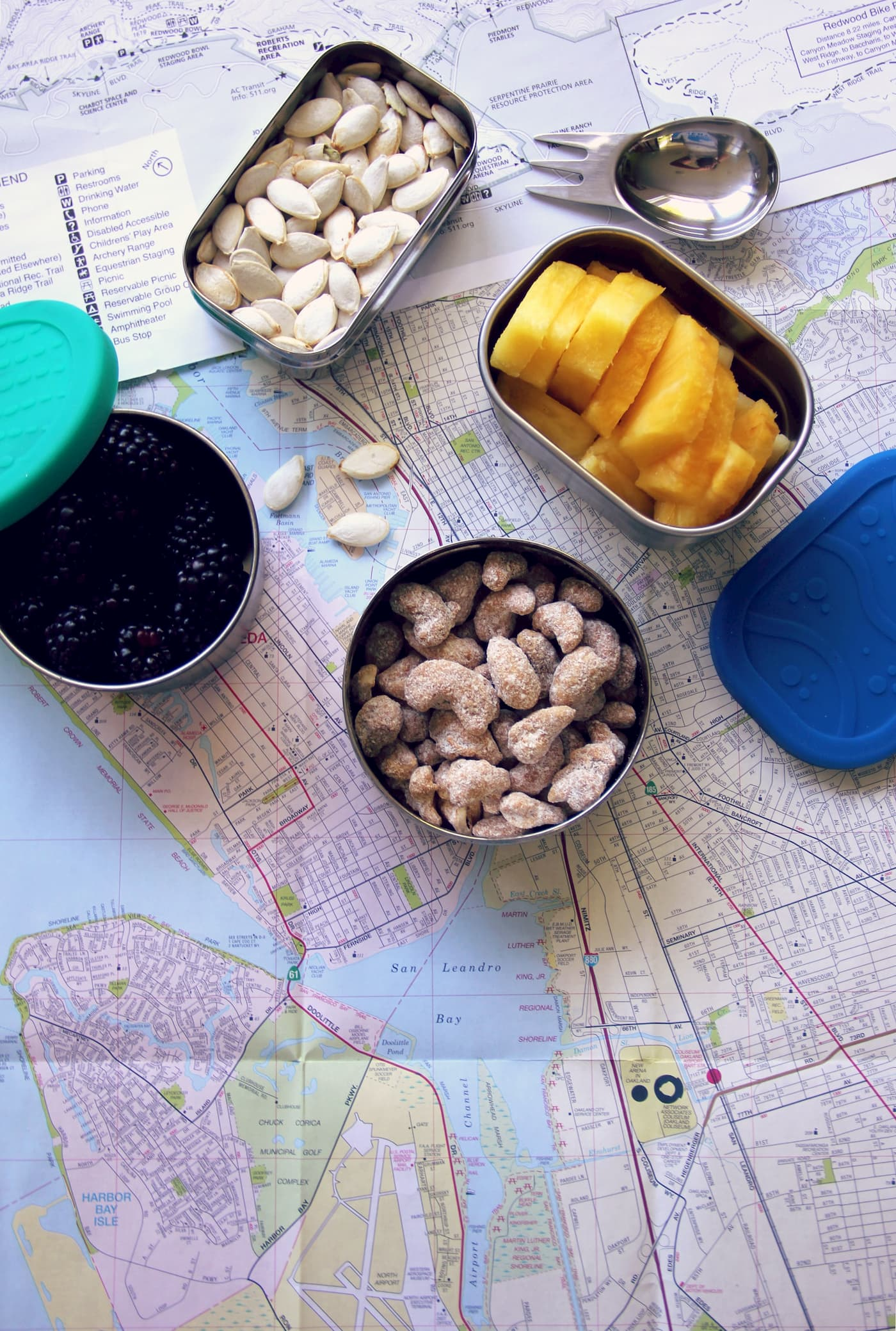 Healthy snacks laid out on a map.