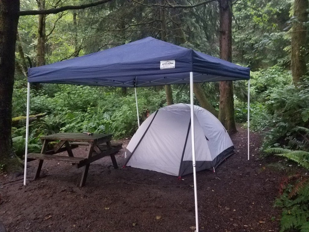 a canopy over a tent on a dirt rock site in oregon
