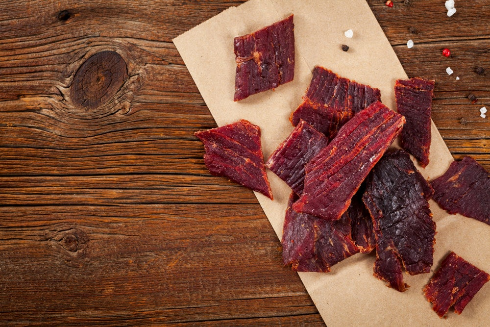 Slices of beef jerky on wood