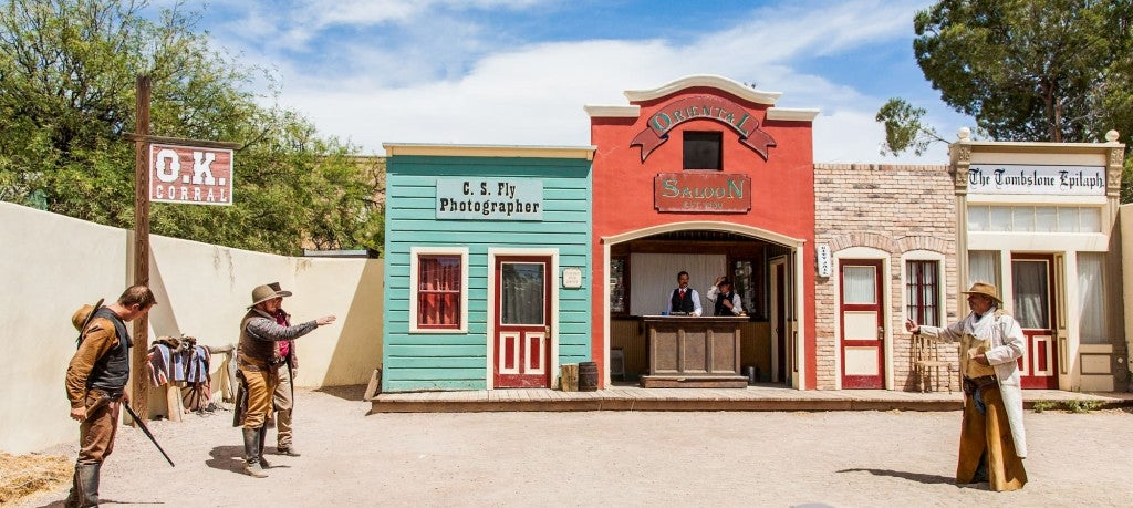 Old, colorful western town with men dressed as cowboys