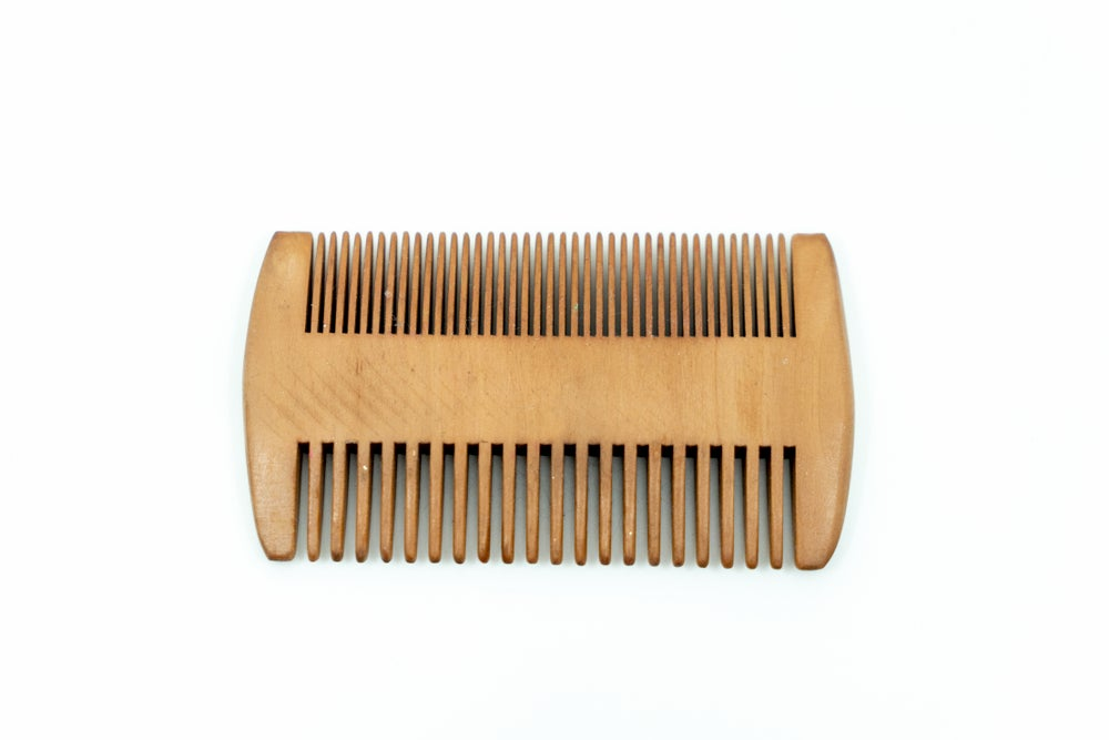 Wooden dual beard comb.