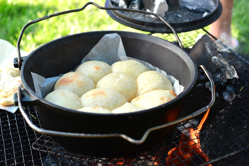 a number of bread rolls baking in a dutch oven