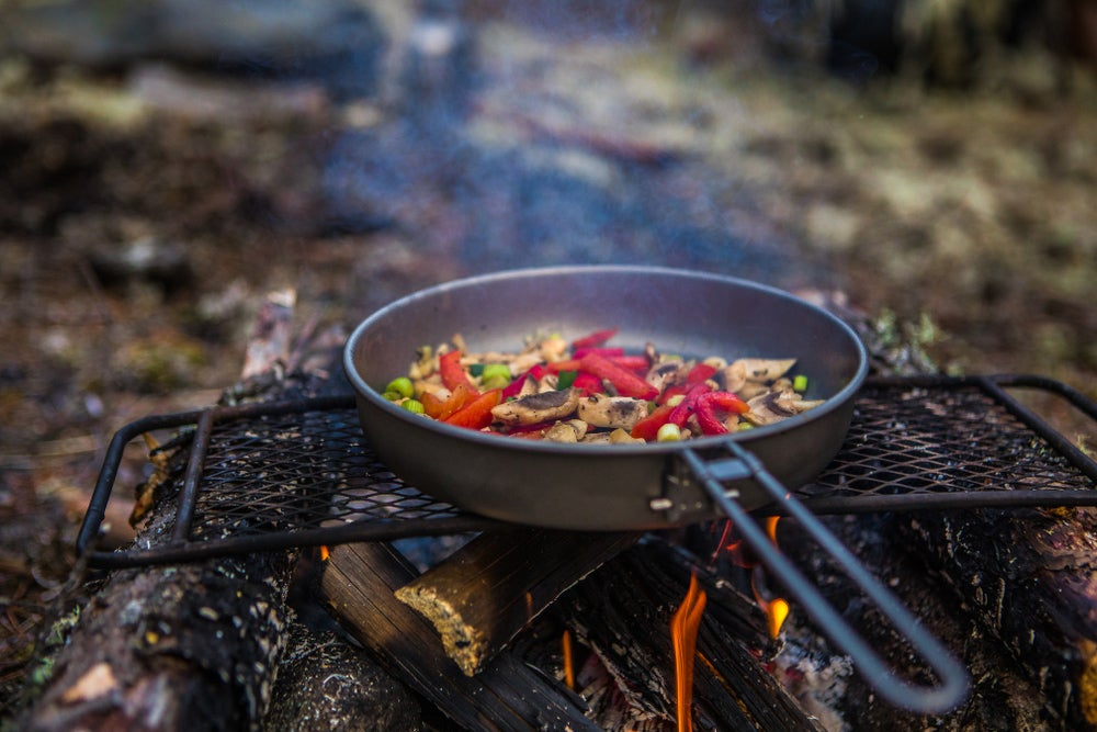 Stir fry in a pan on grill