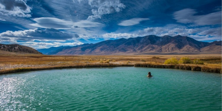 a woman swimming in a blue pool in nevada