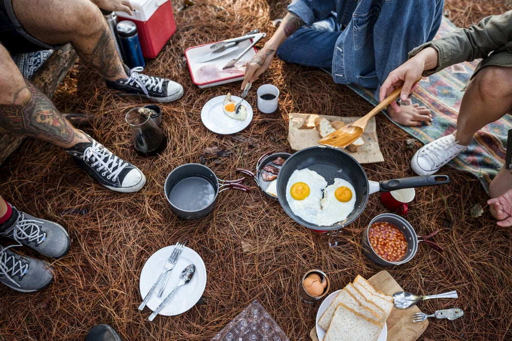 Spread of breakfast including eggs and beans while camping