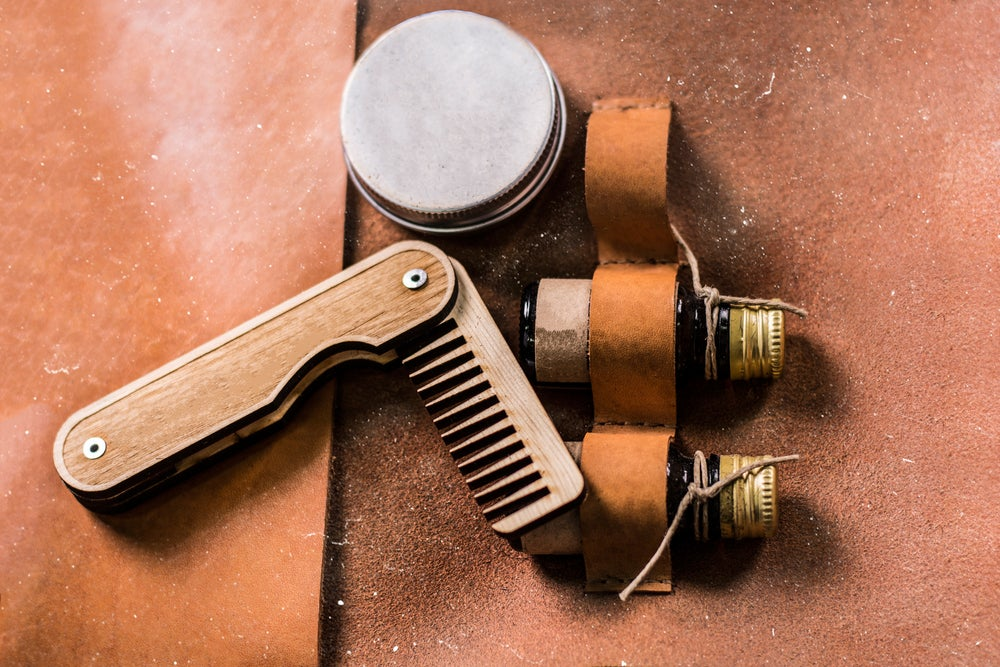 Bear oil and comb in leather travel beard kit.