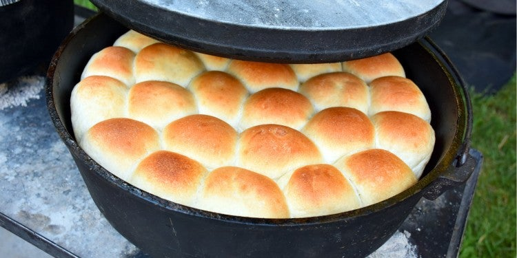 a number of bread rolls in a dutch oven