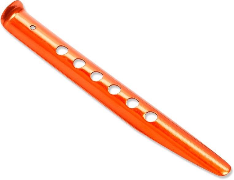 a bright orange tent stake