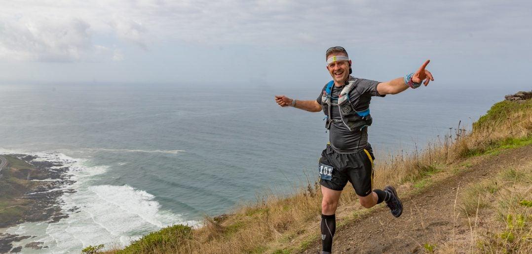 Ultra Runner Mark Friess running along coastal trail in Oregon.