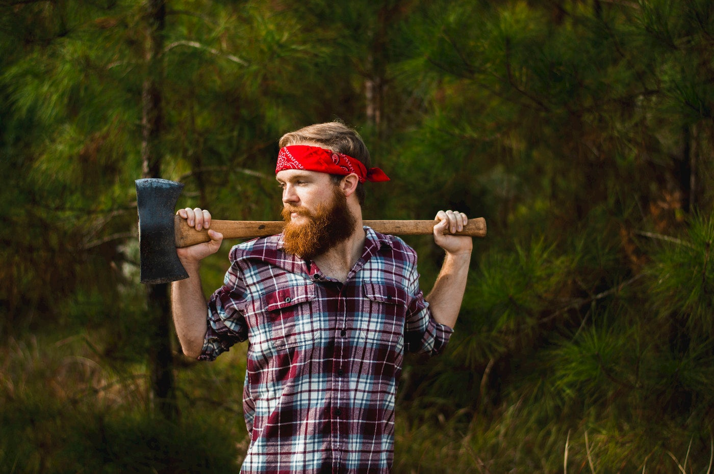 Bearded guy dressed up in a lumberjack costume,