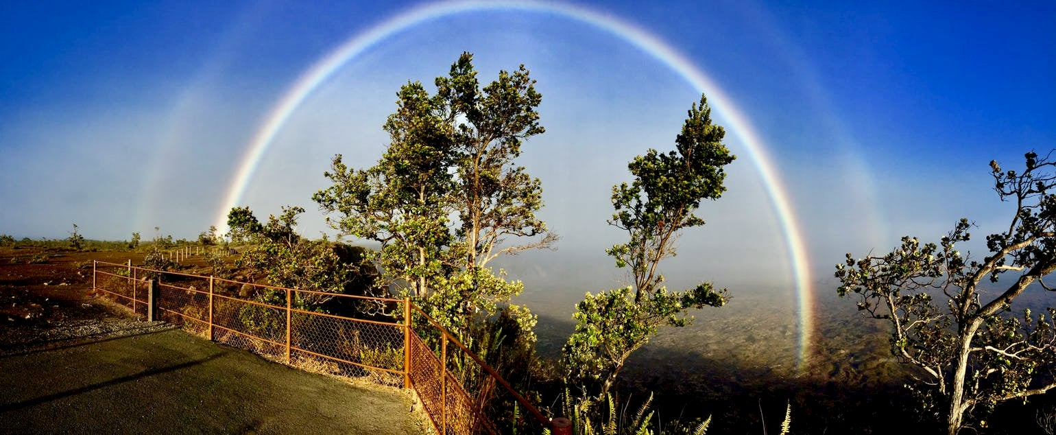 Rainbow over the landscape of Hawaii Volcanoes National Park.