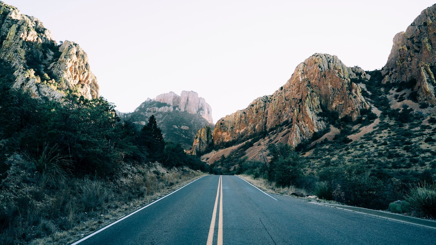 Canyons of Big Bend surrounding a road.