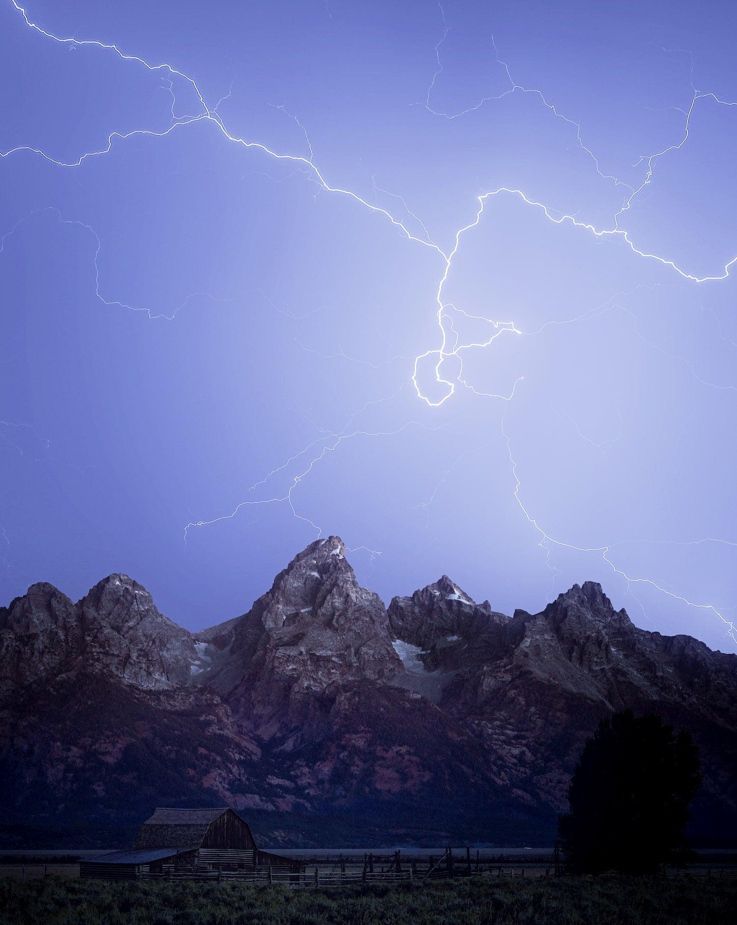Lightning streaks over the Grand Tetons.