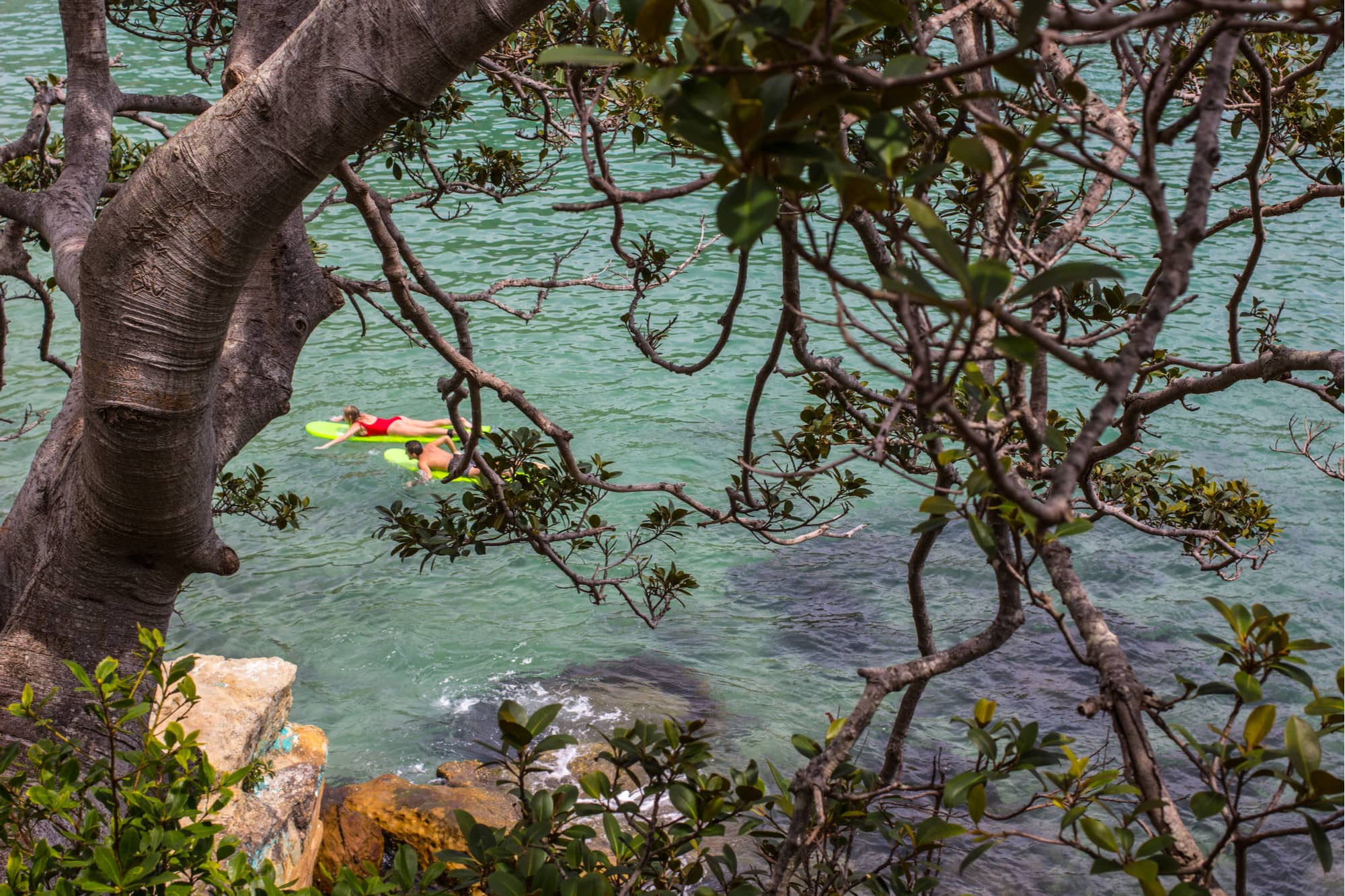 two people floating on the san marcos river