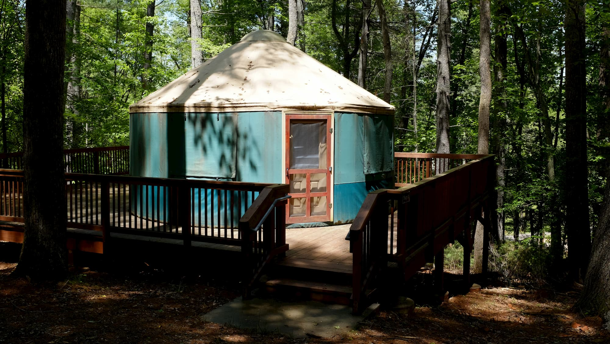 Yurt with porch in the middle of the forest.