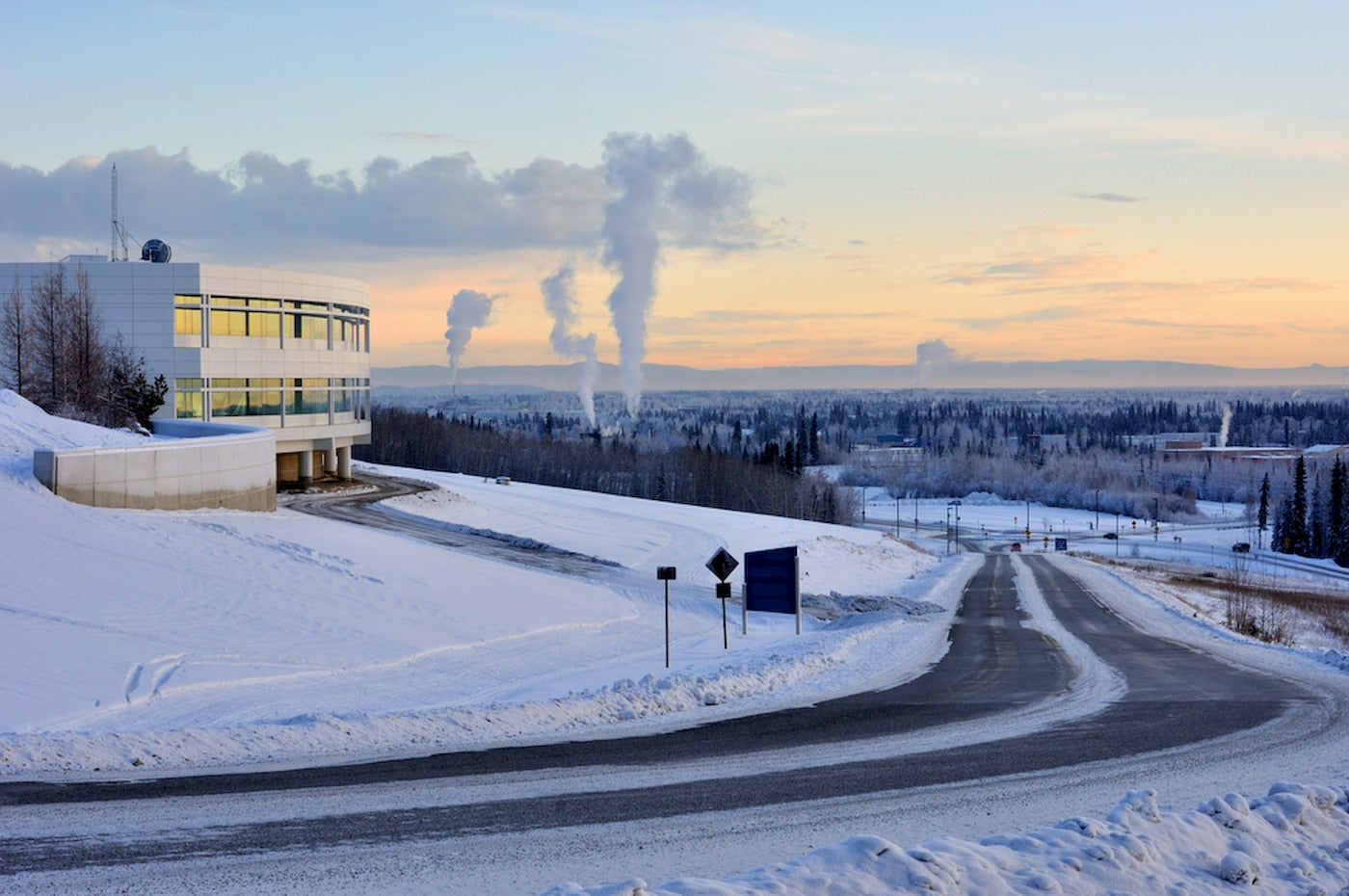 Snow covered landscape of University of Fairbanks at sunset.