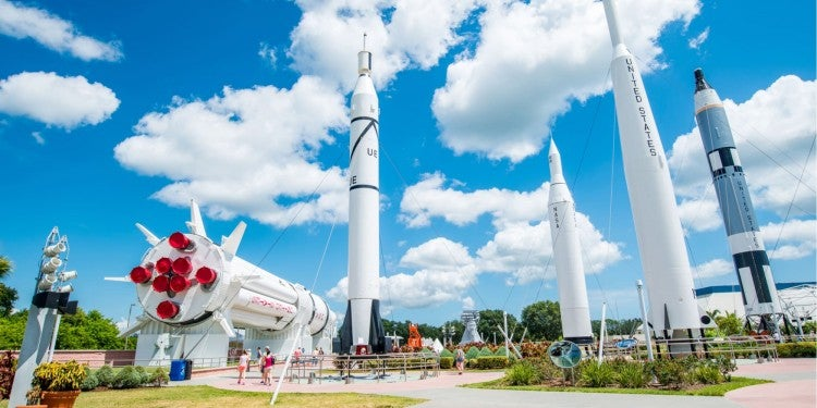 five rockets in a garden at the nasa center in cape canaveral florida