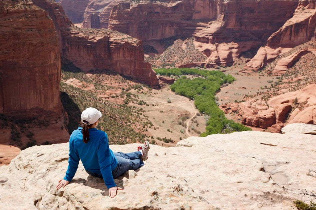Hiker sitting overlooking Canyon de Chelly