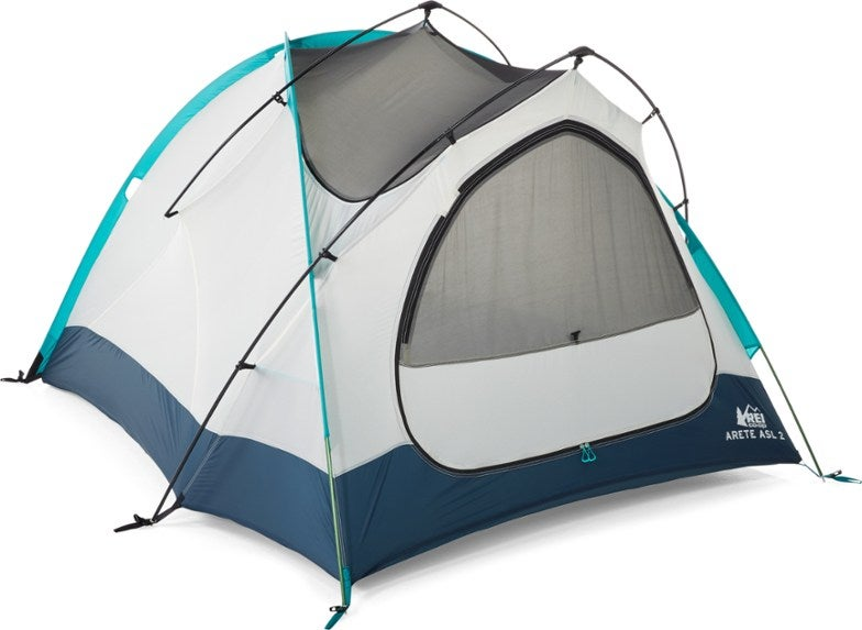 white winter camping tent with blue trim