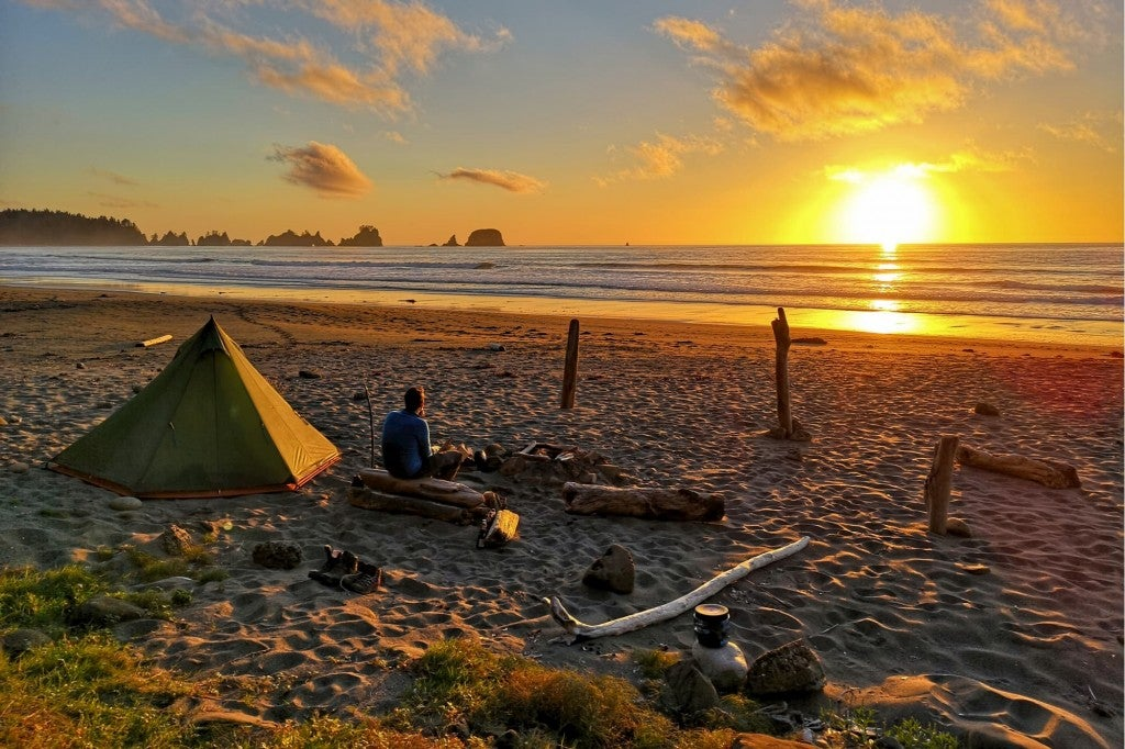 a man camping on the beach