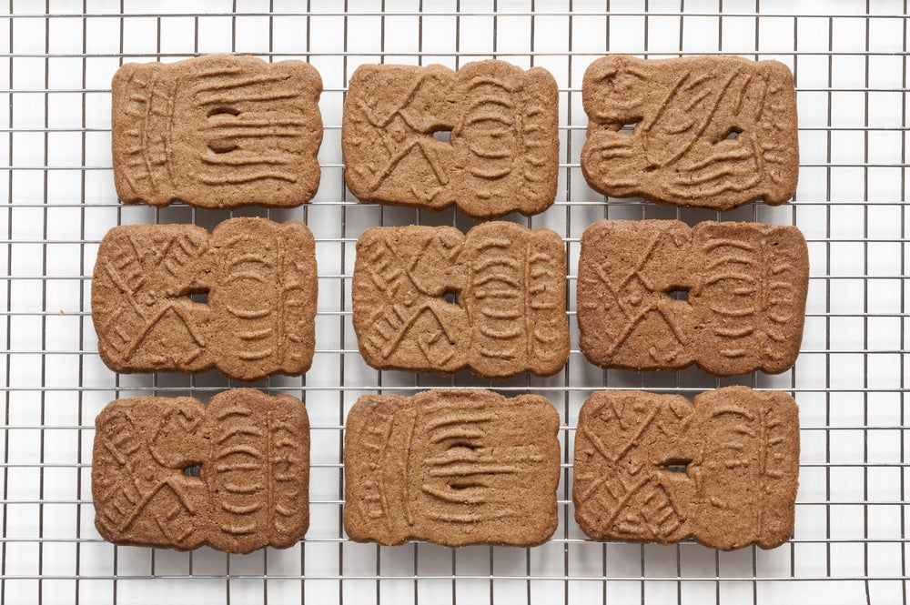 Speculaas cookies on a cooling rack.