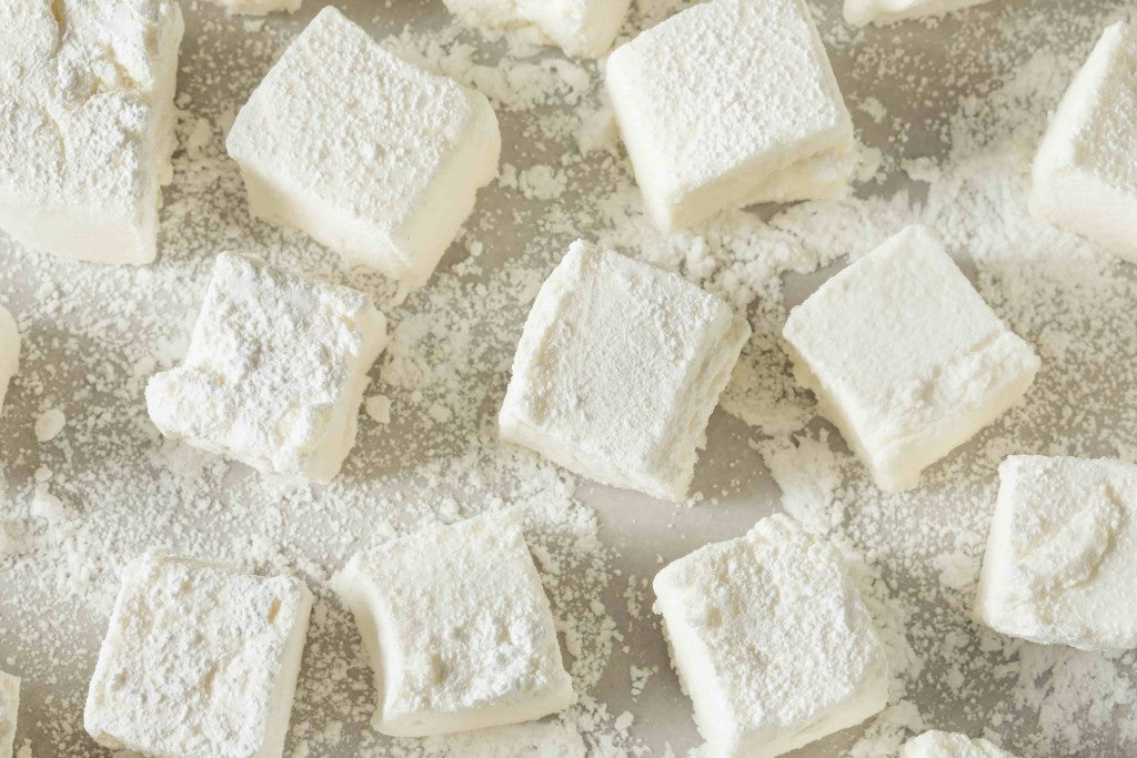 Flour dusted homemade square marshmallows.