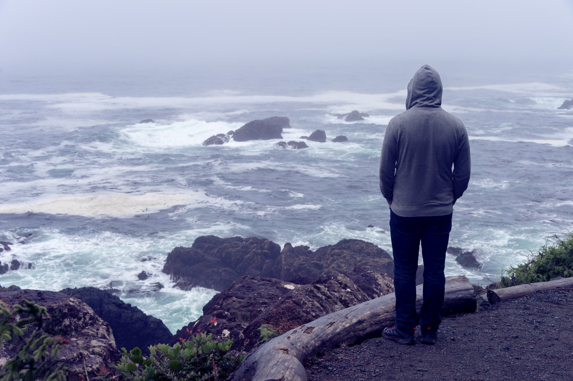 Person looking out at the ocean on a stormy day.