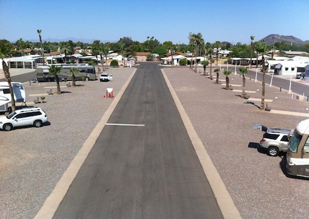 RV Park with palm trees and mountains in the background.