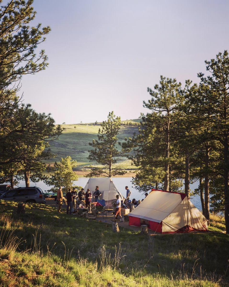 Wenzel tents set up on a hill at golden hour.