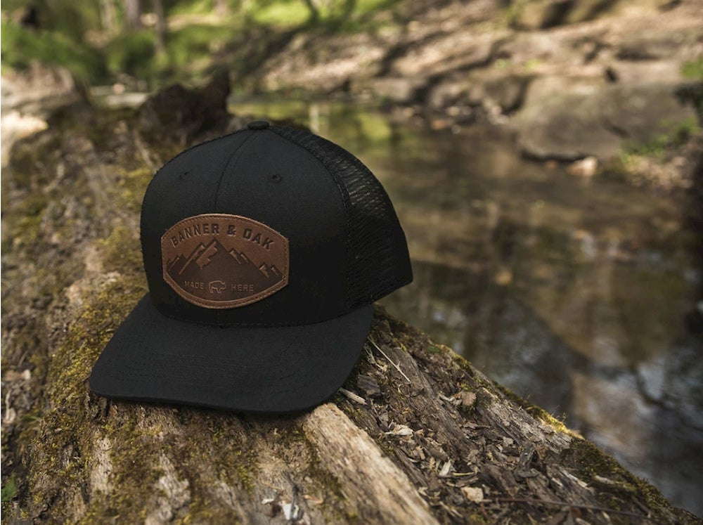 Black hat on a log outdoors.