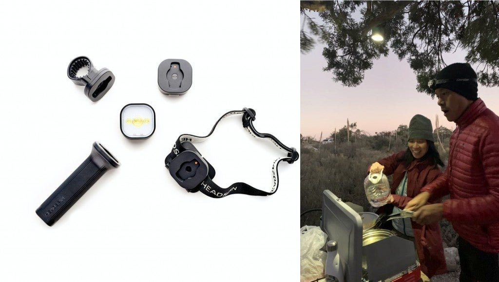 a headspin outdoors light kit next to a camper using the light kit from a tree