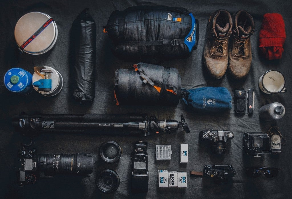 Flat lay of hiking and camping gear.