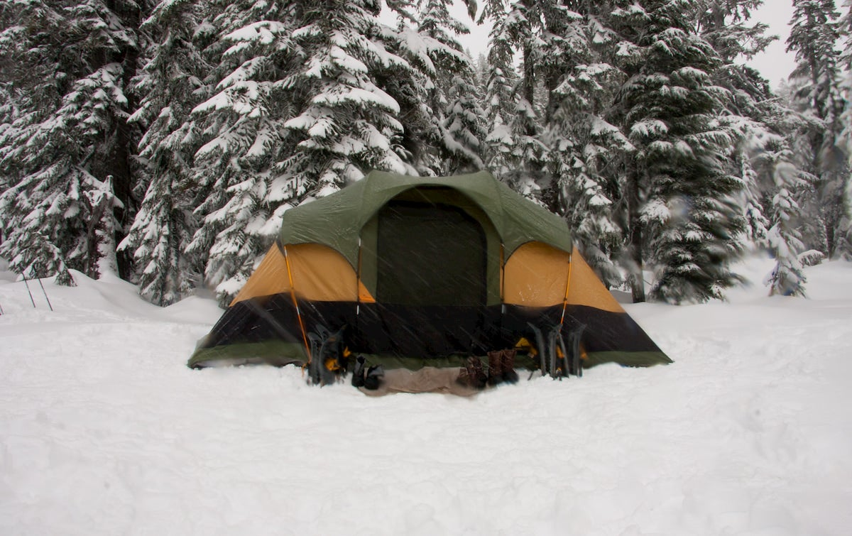Tent in the winter pitched in snow covered landscape.