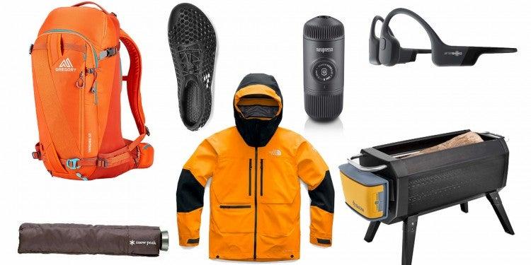 Flat lay of gear: shoes, jacket, umbrella, headphones .