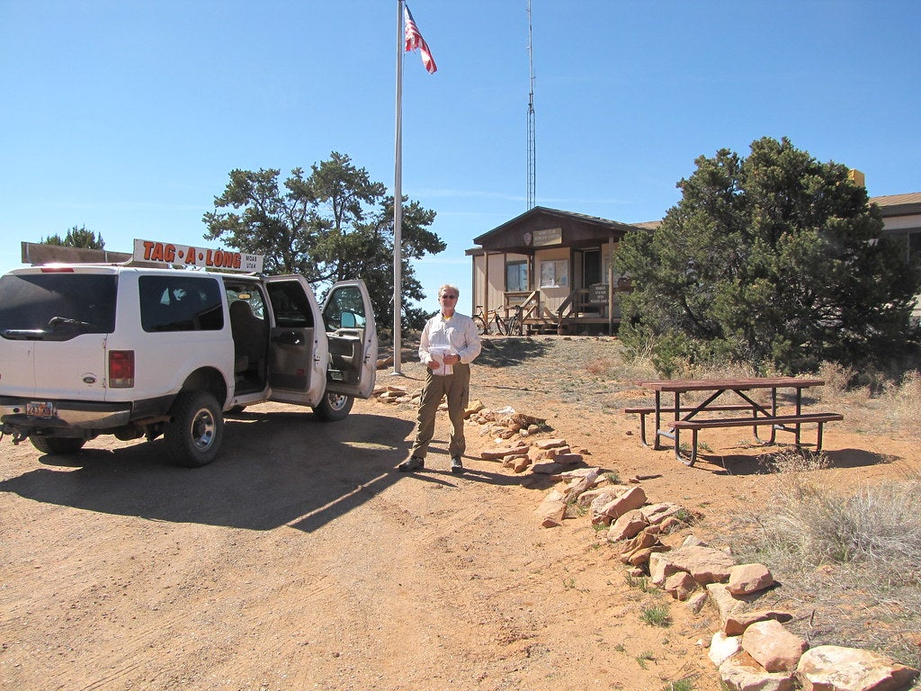 man next to car in front of Hans Flat Ranger Station