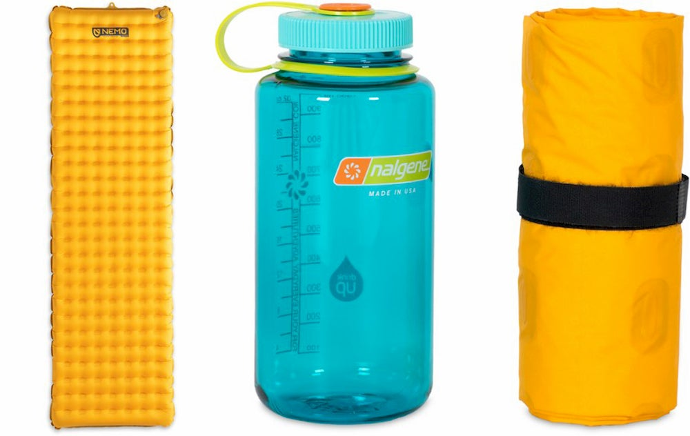 Sleeping pad beside water bottle beside collapsed sleeping pad.