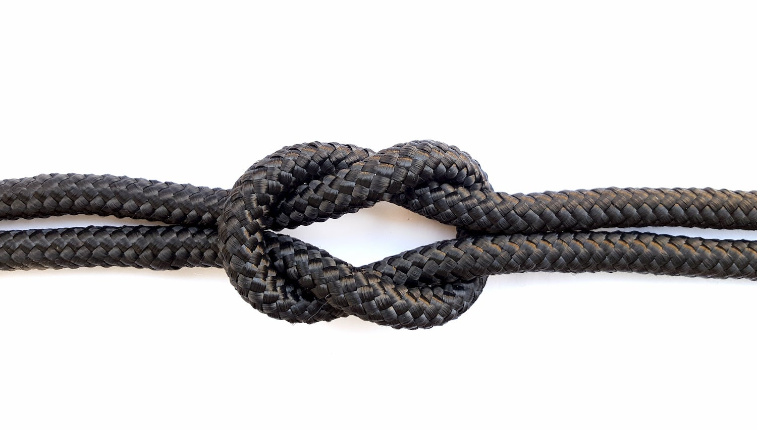 Black rope tied into a square knot.