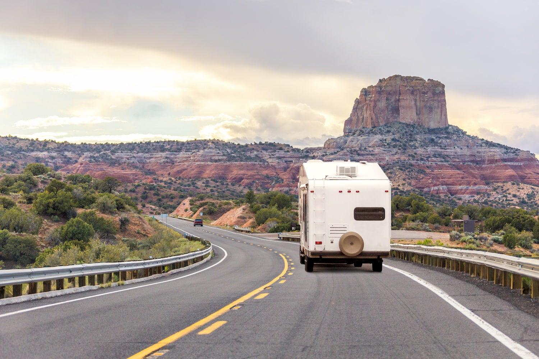 rv camper driving on freeway