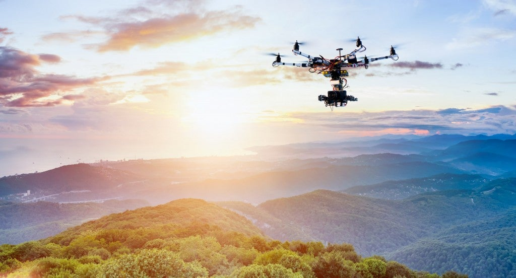 professional drone flying over landscape