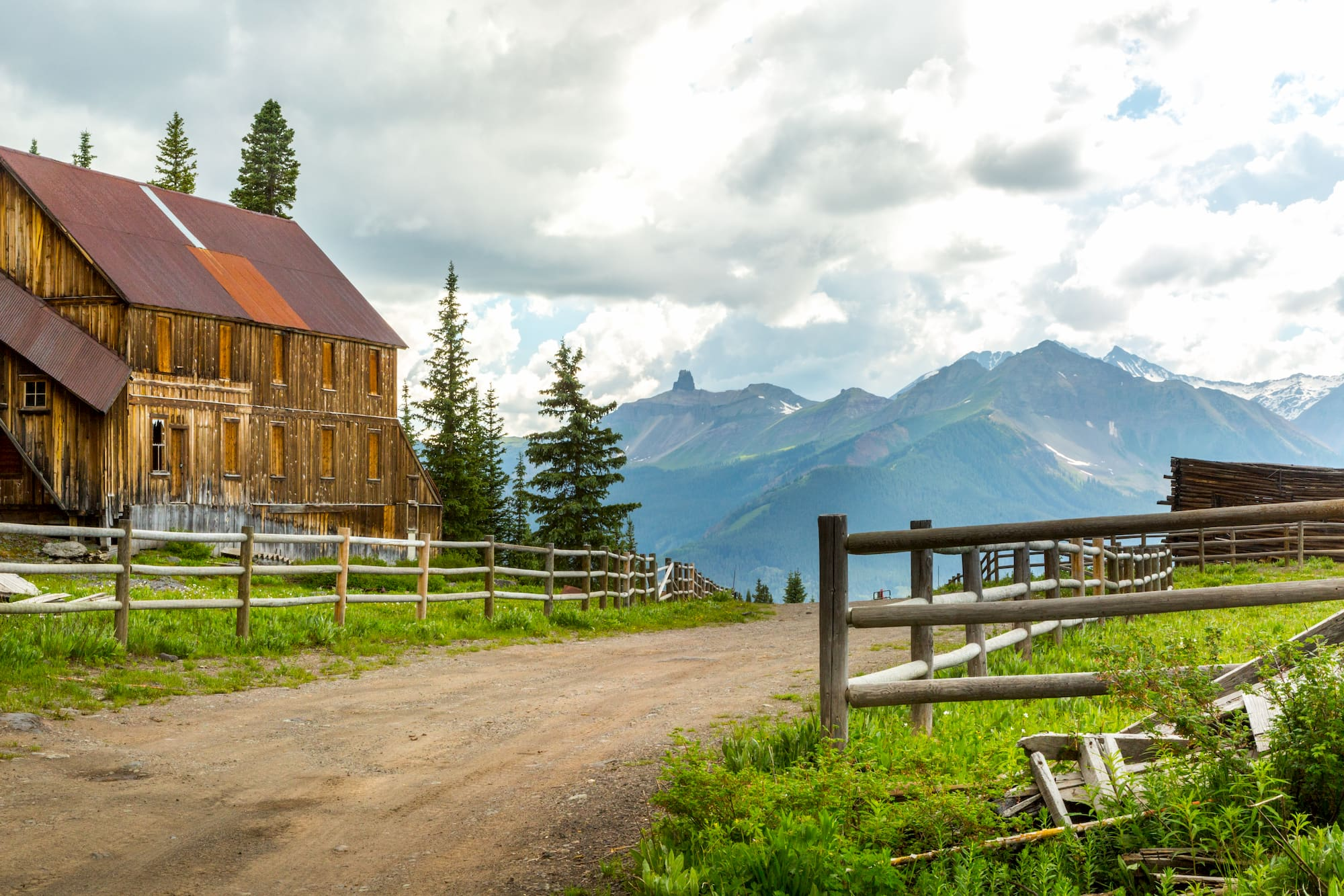 Road going through Alta Ghost Town near Telluride, Colorado, with Lizard Head Peak in the background, San Juan Mountains