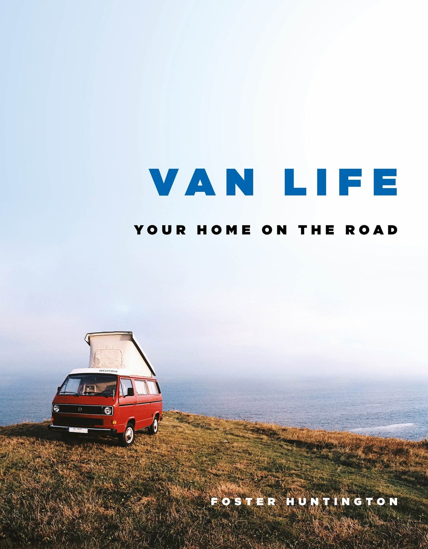 Book with red westfalia van parked beside an ocean on the cover.