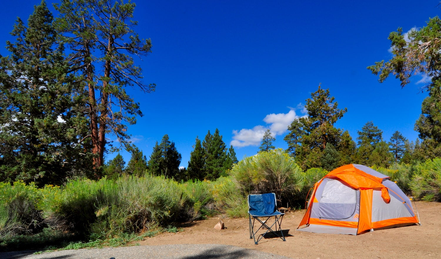 photo of camp chair and tent at campsite