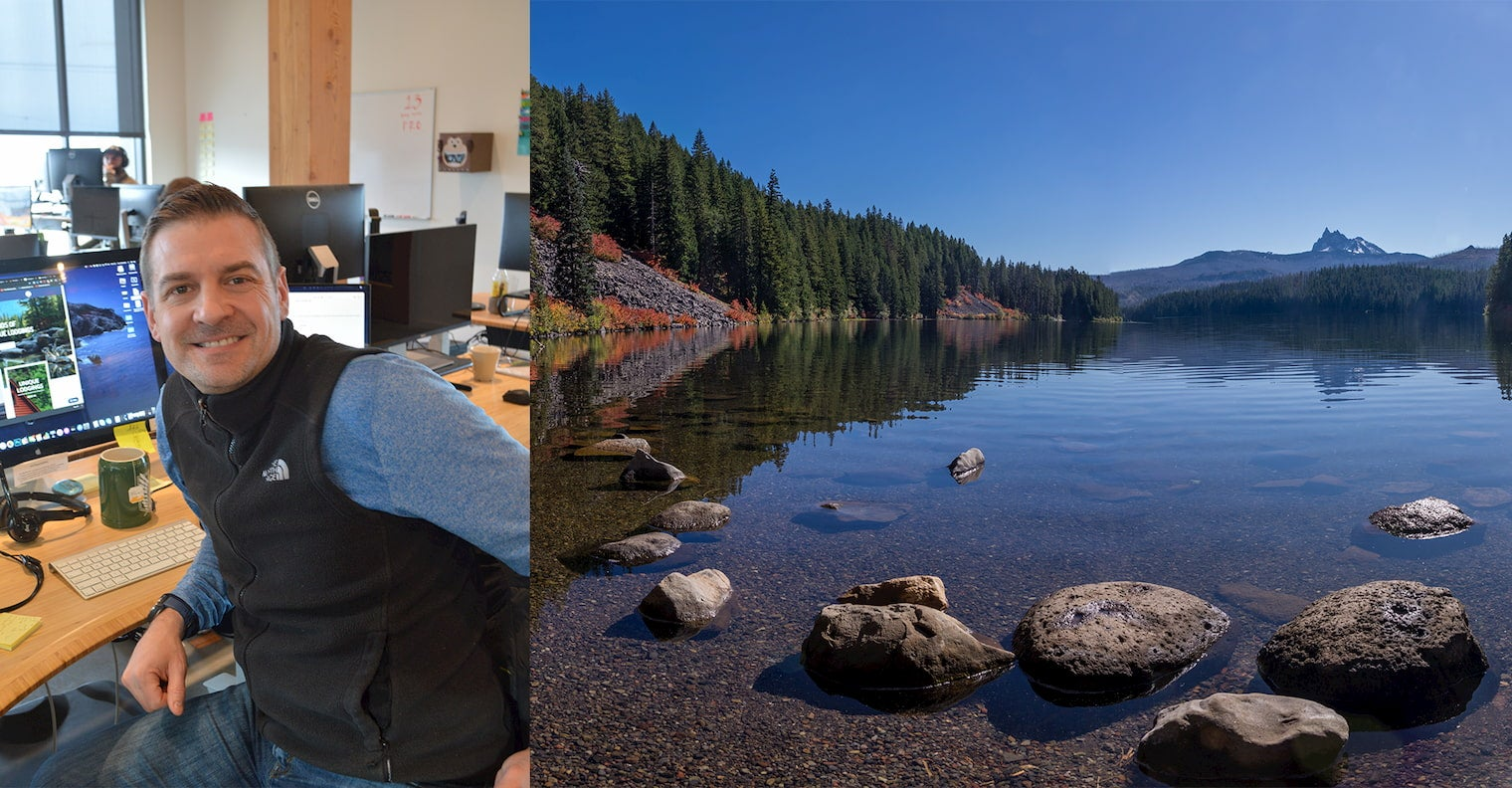 On the left man smiling at his desk, on the right image of lake with small mountain peak in the background.