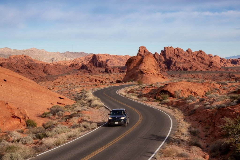 car driving on road through valley of fire state park