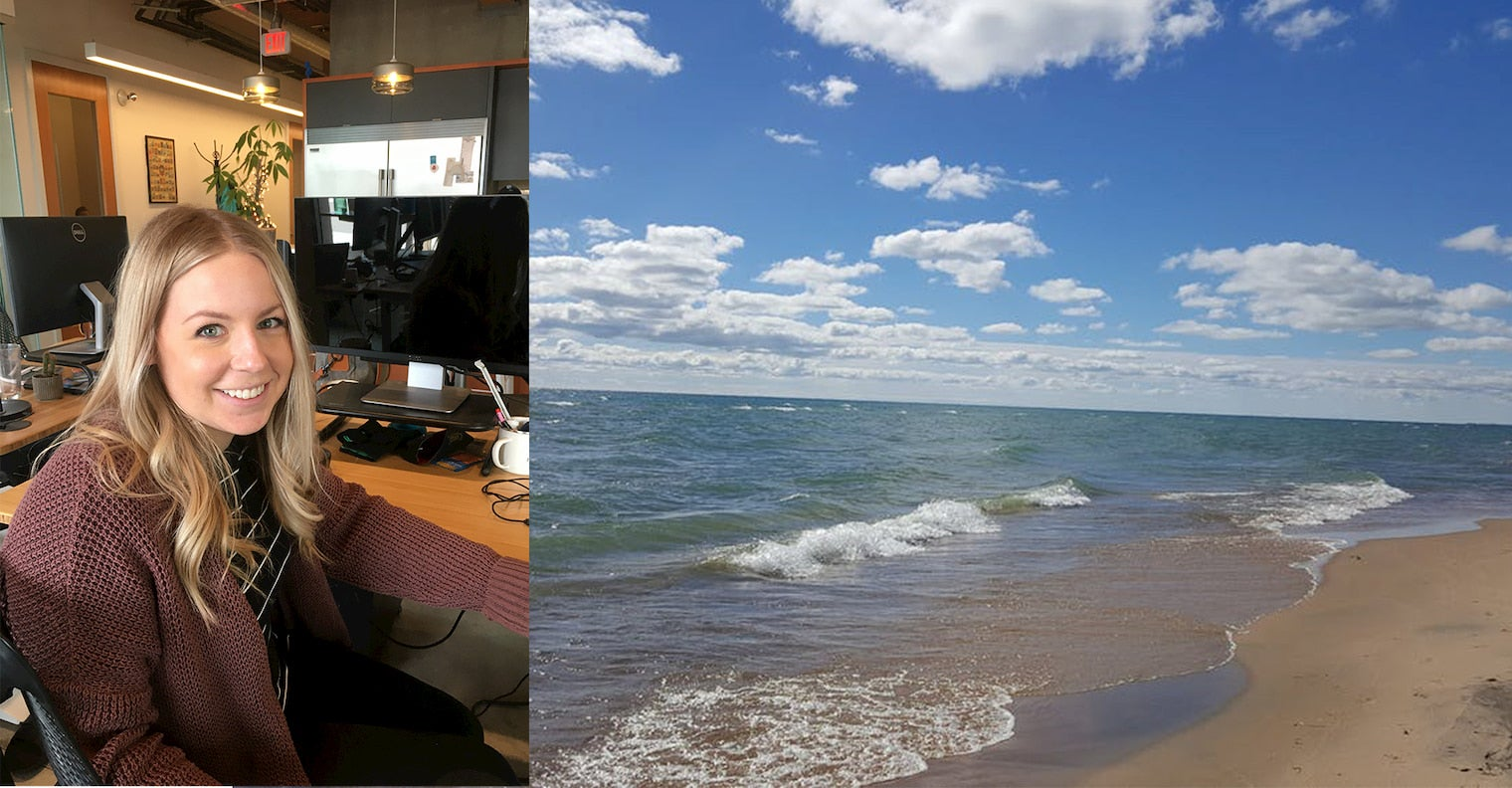 On the right women sitting at her desk in front of a computer screen, on the left, beach with blue sky and cumulous clouds.