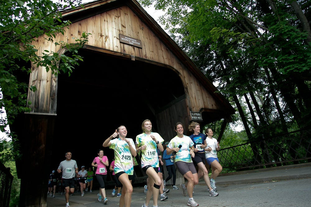 runner coming out from under covered bridge