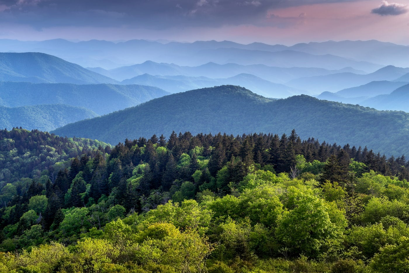 Landscape of mountain peaks in the Smokey Mountains at dusk.