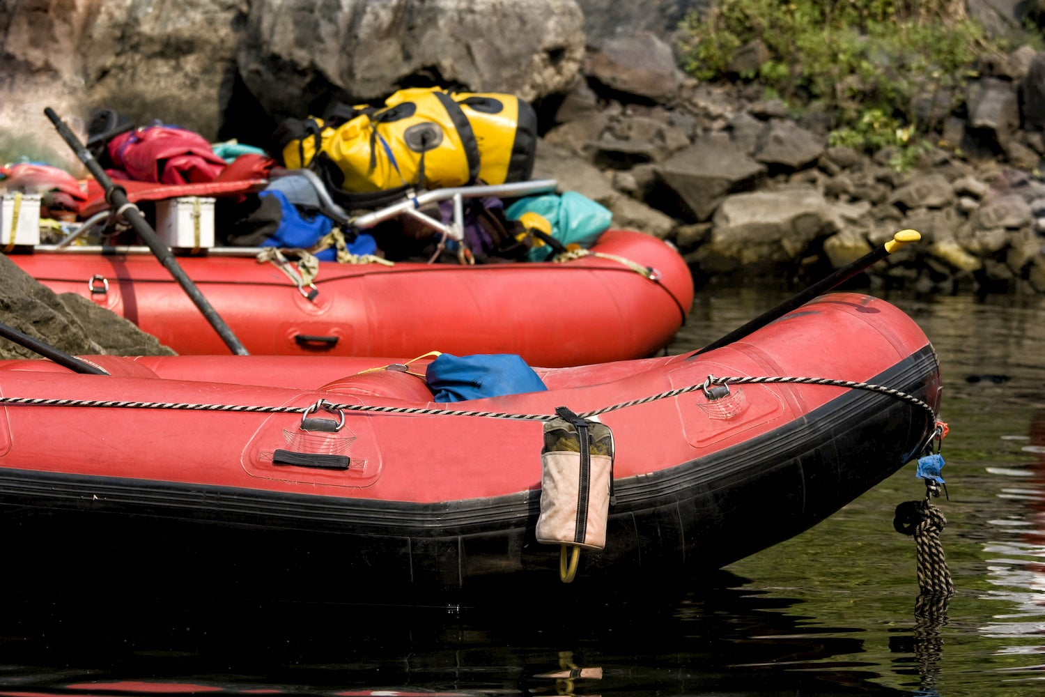 line-up of rafts with gear on them